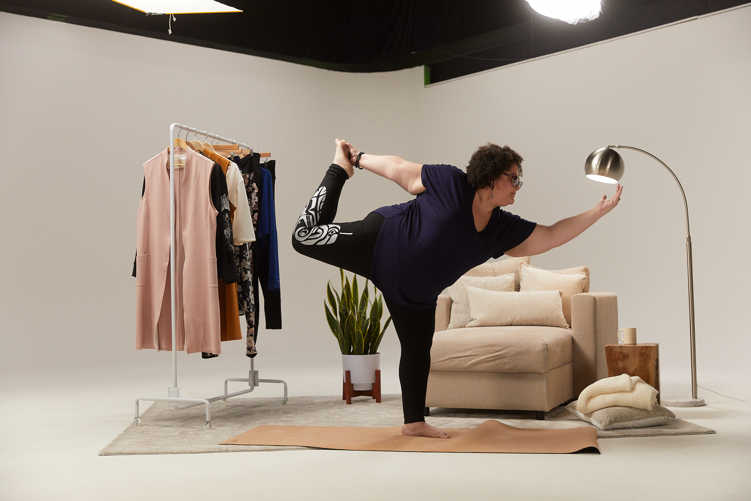 A photo of a person doing yoga for the Anne Mulaire inclusive sizing announcement.