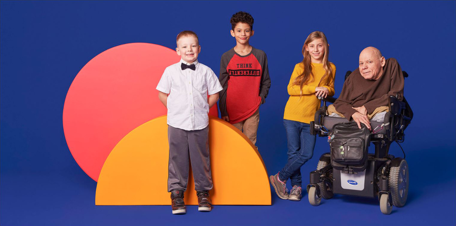 Still of a father and his children in front of bright circles on a purple background.
