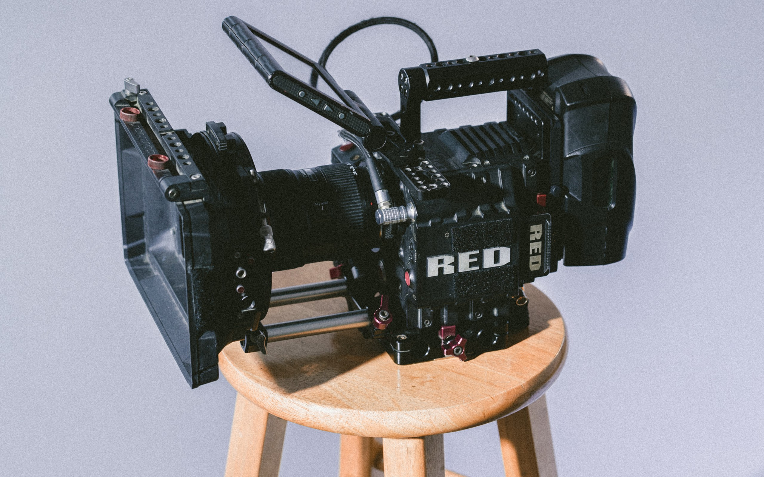 Video camera sitting on a wooden stool