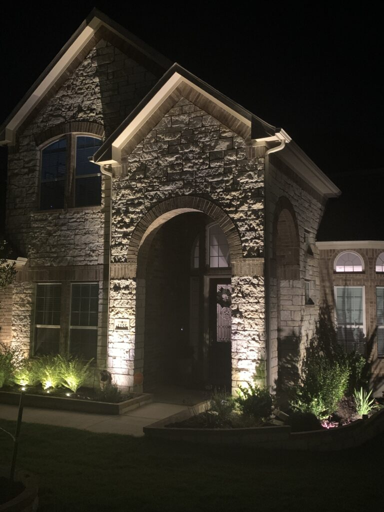 A picture of the front of a house that has installed new outdoor lighting from a professional landscape lighting company in Austin Tx