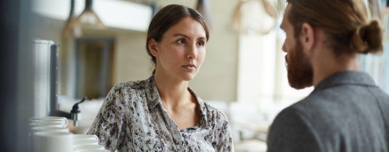 woman listening to man talk personal injury fargo