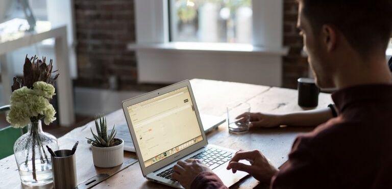 man typing business law fargo