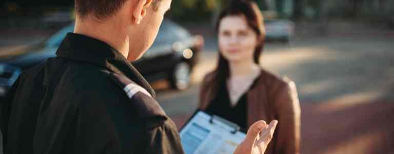 officer talking to girl criminal law fargo