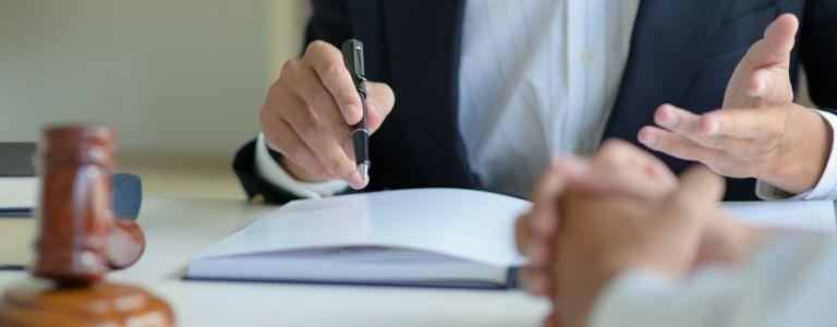 man signing document plea bargain criminal law fargo north dakota