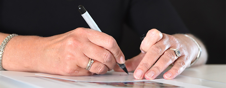 woman signing a will real family law north dakota