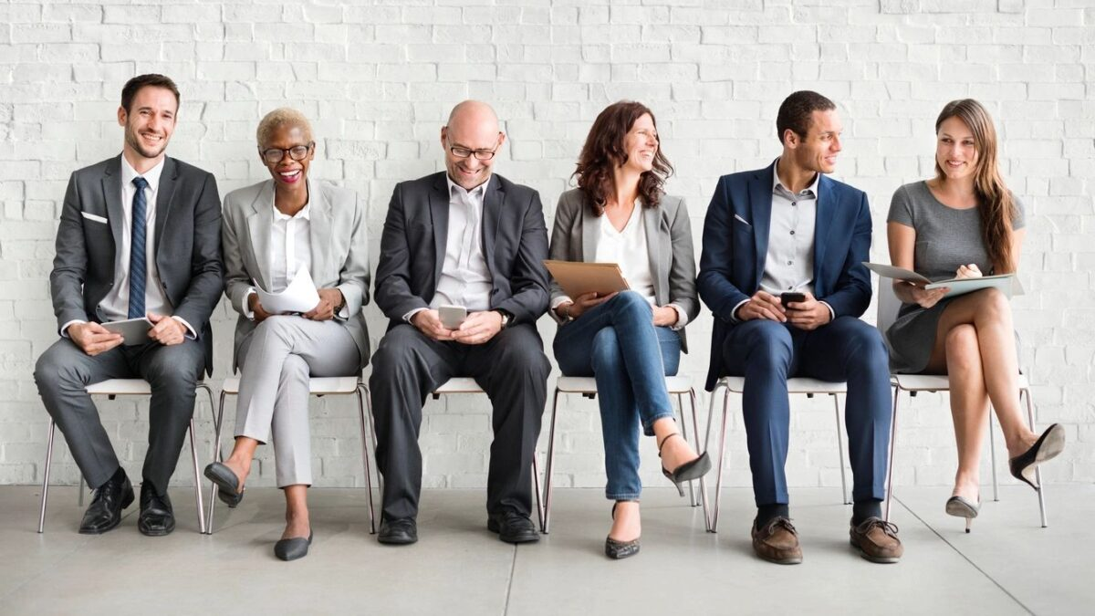 Happy Employees Sitting Together Image