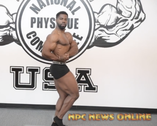 NPC Classic Physique Ken Rogers runs through his posing routine at the NPC Photo gym.