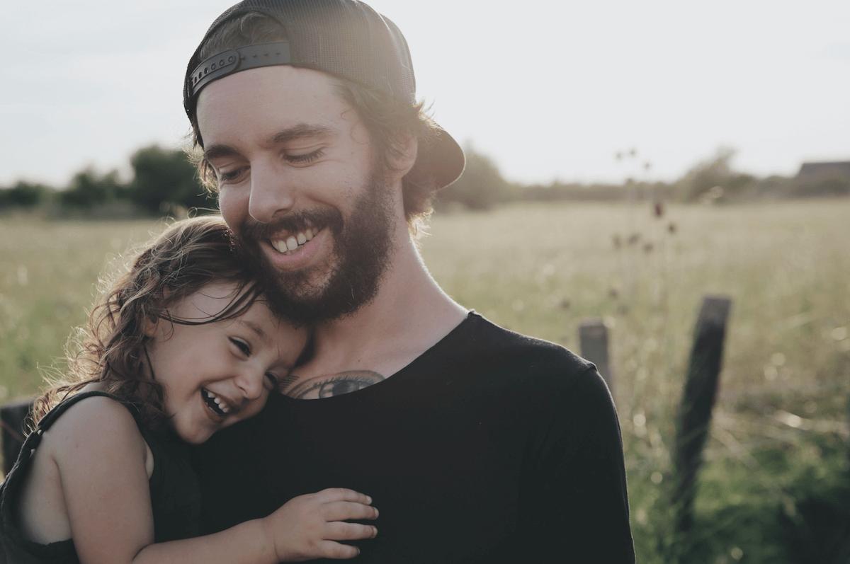 man holding daughter