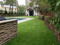backyard landscaped with artificial grass