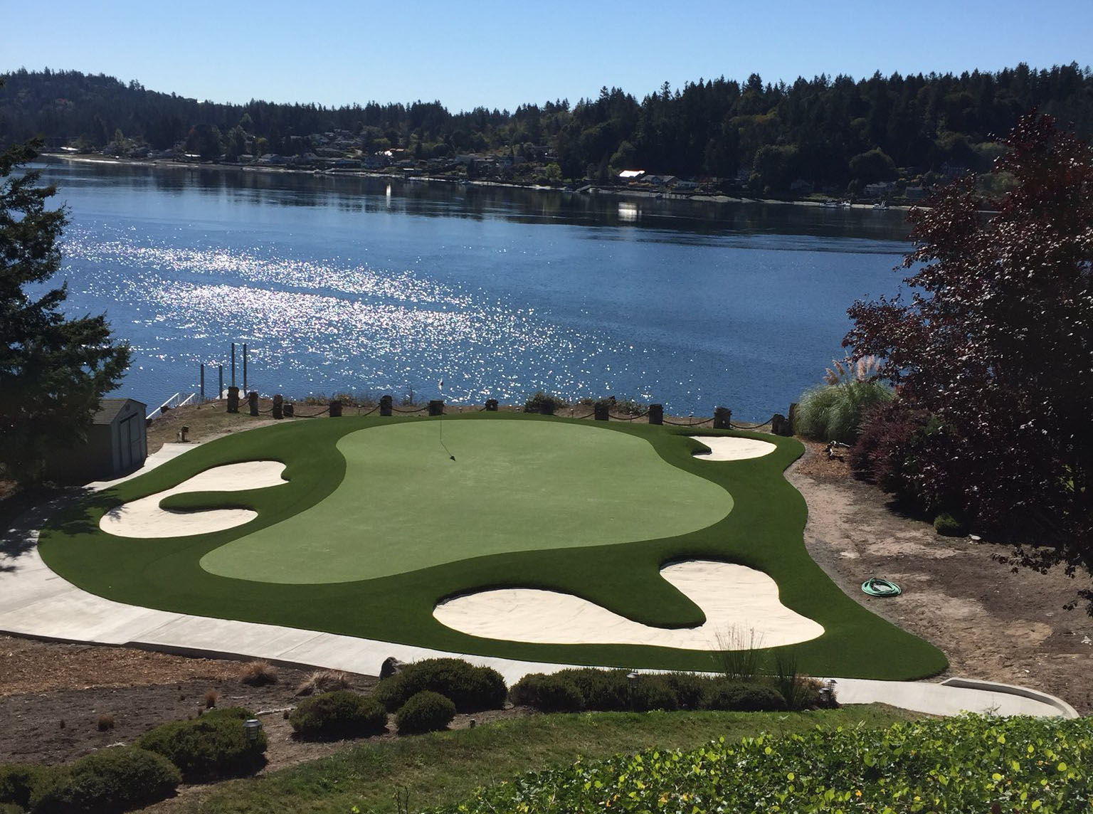 synthetic turf golf green with bunkers on water