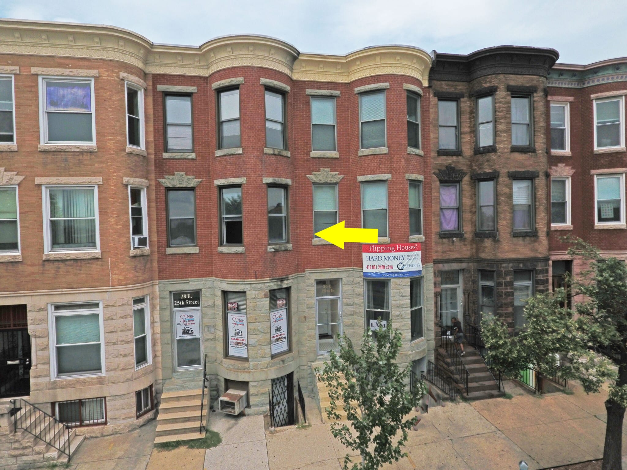 28 East 25th St: 2 Stores + 2 Apartments – 100% Leased in Charles Village