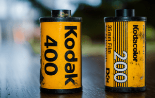 Kodak film roll and kodak film box on wood table and vintage background