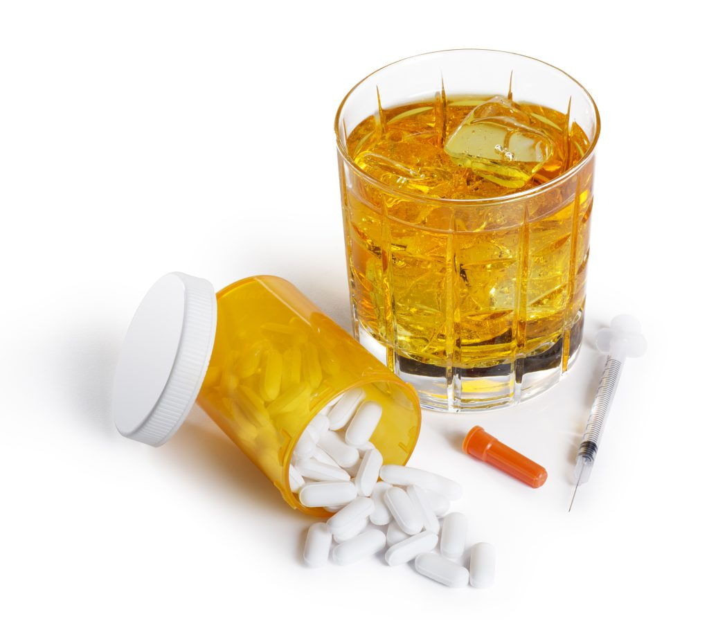This is a photo of a glass of alcohol and a drugs isolated on a white background. There is a clipping path included with this file.Click on the links below to view lightboxes.
