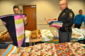Quilting group makes warm donation to Sheriff's Office