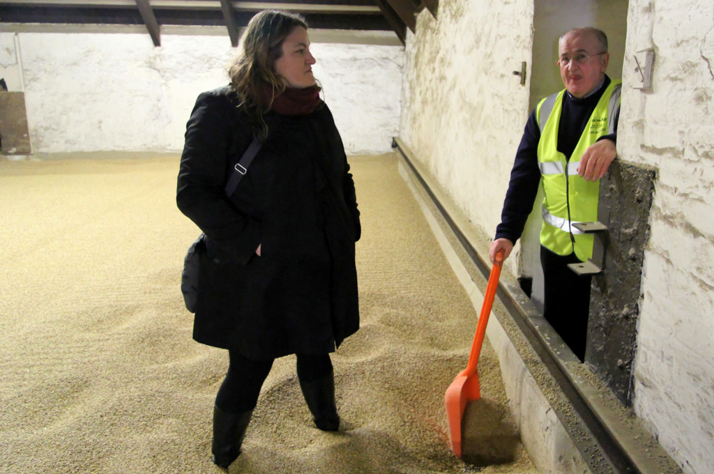 Mrs. Wonk and Eddie MacAffer in the drying room, Bowmore distillery