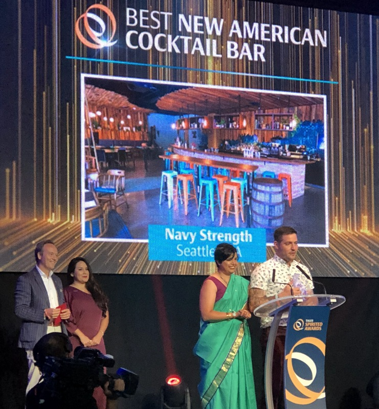 Anu and Chris Elford accept the Best New American Cocktail Bar award for Navy Strength