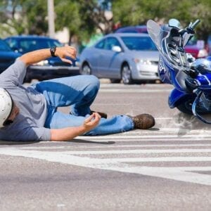 Motorcycle accident lawyer St Petersburg - Photo of a man on the ground after a motorcycle accident.