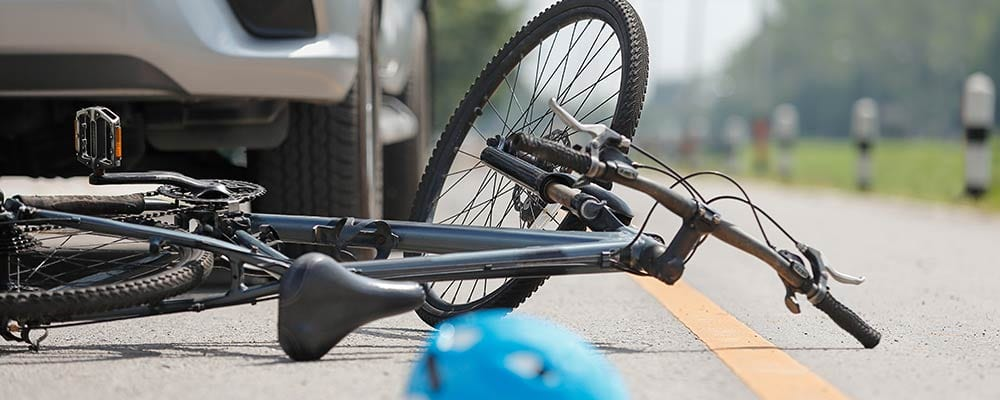 Bicycle accident lawyer St Petersburg Florida - Photo of a bicycle on the ground and a car in front of it