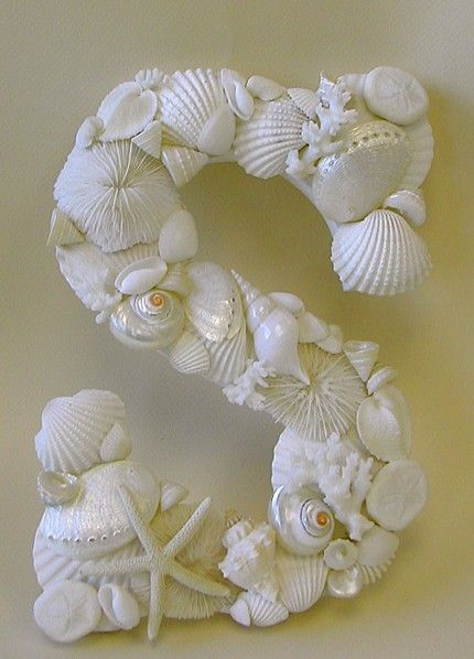 Seashells On A Craft Wood Letter