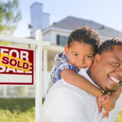 man and son with real estate sign