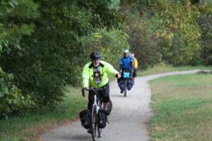 three bicyclists in rain gear