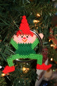 another ornament--an elf sitting in ring