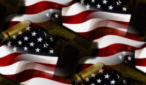 american flag, gun, and bullets