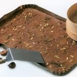 Castagnaccio, taart van kastanje en pijnboompitten