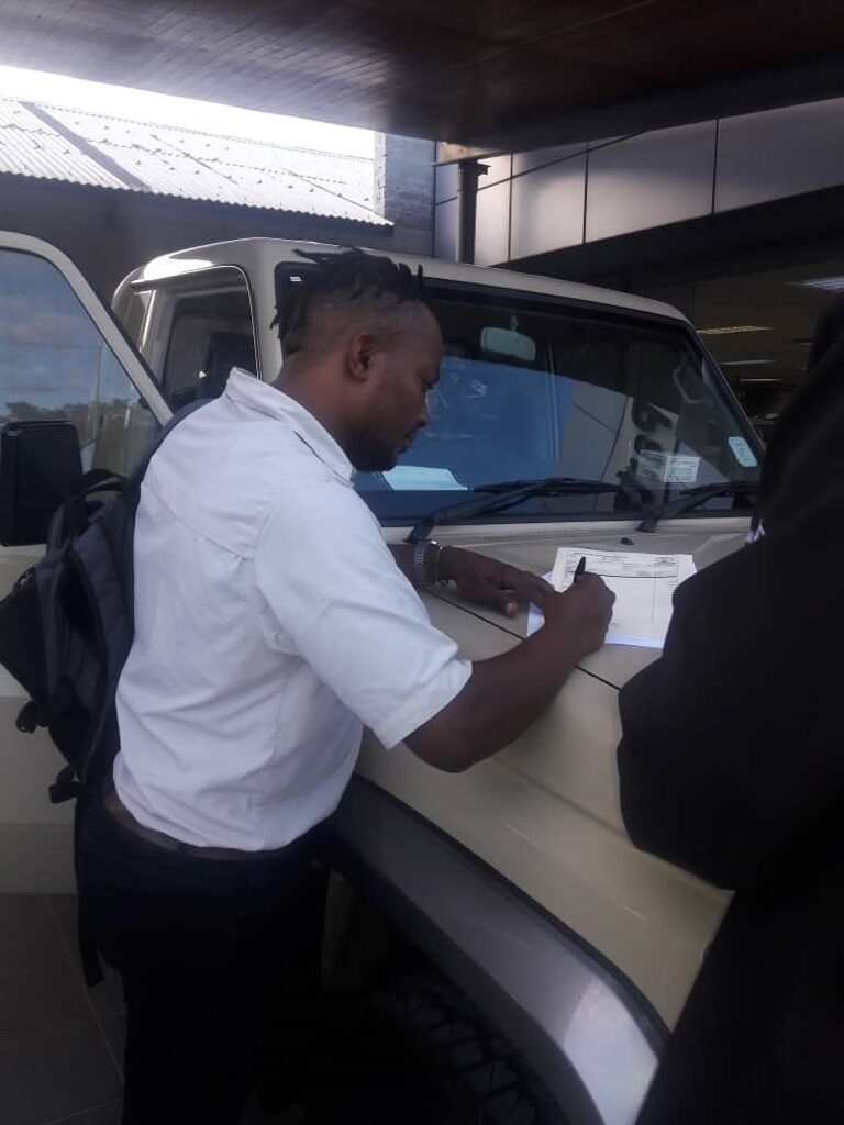 Signing the Papers for our Toyota Landcruiser