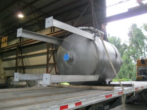 Steel tank on flatbed leaving Savannah Tank facility