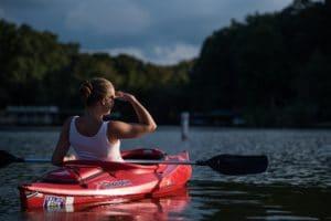 Kayaker Watching Manatees and Dolphins