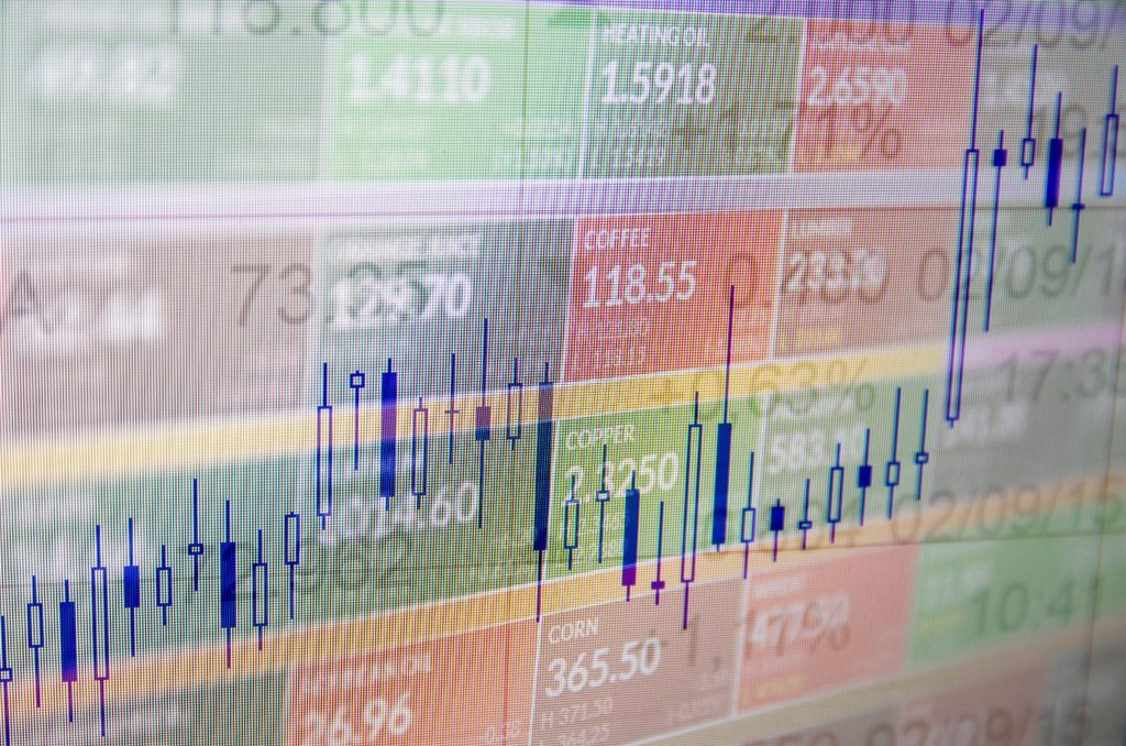 Close-up computer screen with trading platform window. Multiple exposure photo.
