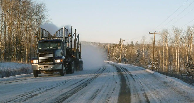 truck driving too fast for dangerous conditions on icy road