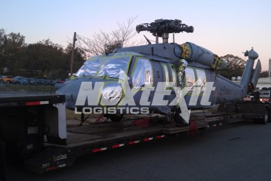 Navy helicopter on double drop trailer heavy haul shipment