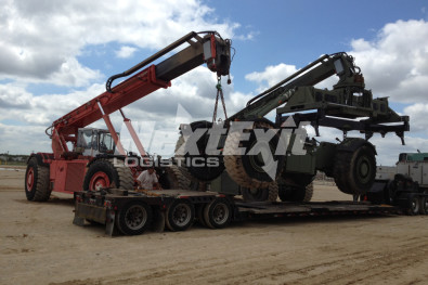 Loading construction equipment onto trailer