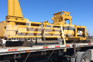 Specialty construction equipment loaded on a flatbed trailer