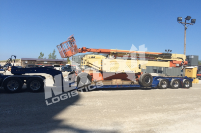 JLG Boom Lift loaded on a double-drop trailer