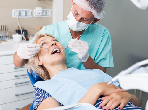 woman at the dentist getting a tooth removed haverford pa
