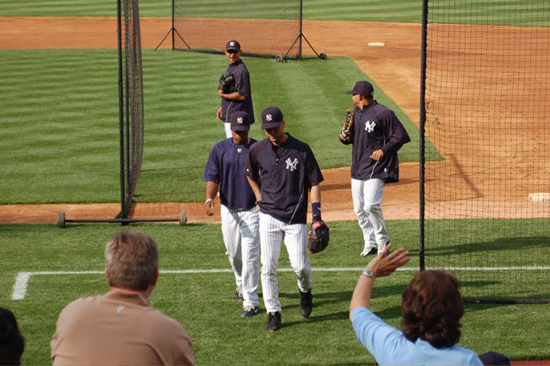 Jeter coming in from shagging flies in the outfield.