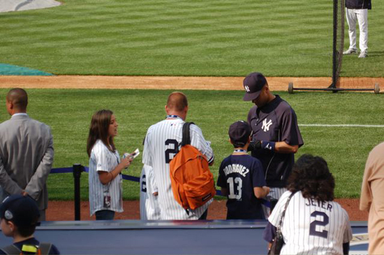 Jeter signs for YSL contest winners including Madeleine Baxter, left, and Josh Adams (with backpack).