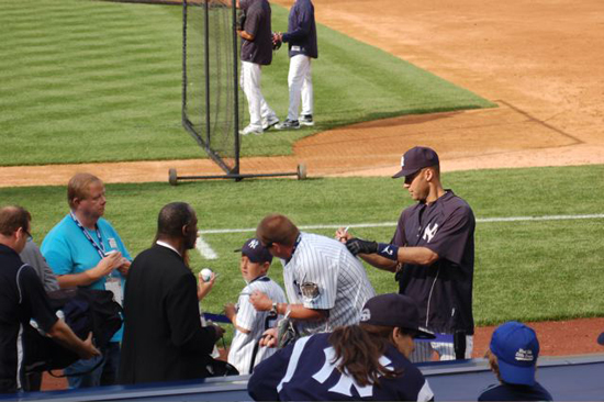 Jeter signs Josh Adams's Yankee jersey on the No. 2.