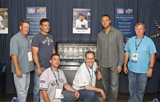 The five winners from Upper Deck's Yankee Stadium Legacy Collection contest pose with Yankees Team Captain Derek Jeter alongside the YSL card collection that was on display at the NYY Steak restaurant in New York on June 16. From left: Kent Hayes, Tommy Baxter, Josh Adams, Leo Wiznitzer, Jeter and Chuck Sauter.
