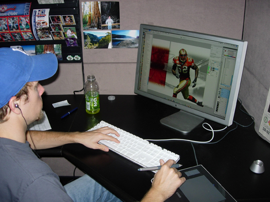 Tim puts the finishing touches on photography color enhancements.