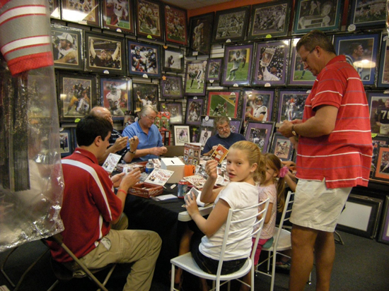Collectors enjoying Upper Deck's 2009 MLB Goodwin Champions set at a recent promotional night