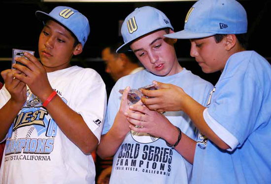 CHECK THIS OUT: Teammates Andy Rios, Seth Godfrey and Daniel Borras Jr. admire each other's cards.