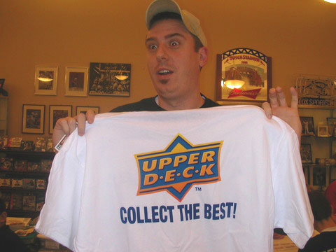 One of Fox Sports Cards customers showing off an Upper Deck shirt he won at a trade night.