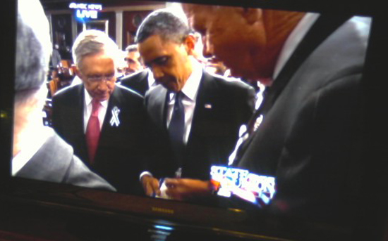 Baarck Obama Signs additonal autographs following his State of the Union Address.