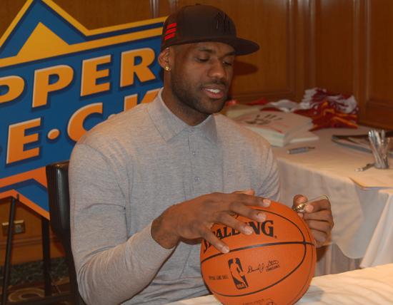LeBron James Signs a Basktball for UDA.