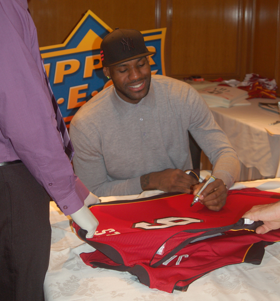 LeBrn James Signing Red Miami Heat Jersey for UDA