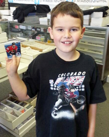2014-Upper-Deck-National-Hockey-Card-Day-Young-Kid-Fan-Holding-Cards